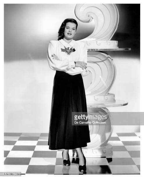 Actress Janis Paige models a blouse with an eagle embroidered on it, in a publicity shot from the late 1940's, United States.