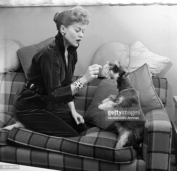 Actress Janis Paige poses at home with her dog in Los AngelesCA