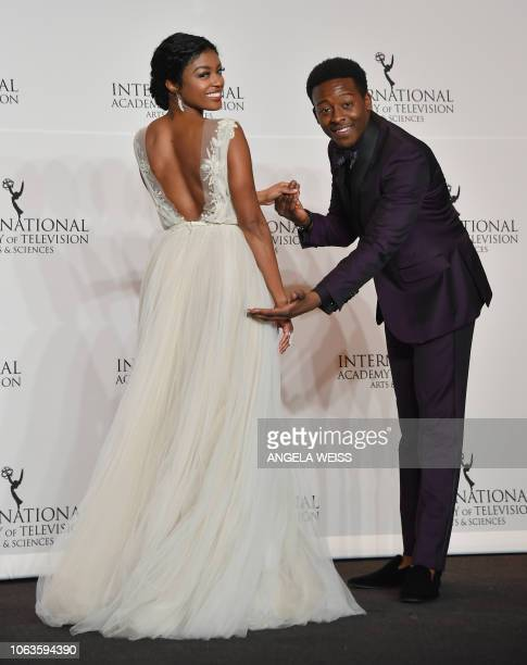 Actress Javicia Leslie and actor Brandon Micheal Hall pose in the press room during the 46th International Emmy Awards gala in New York City on...