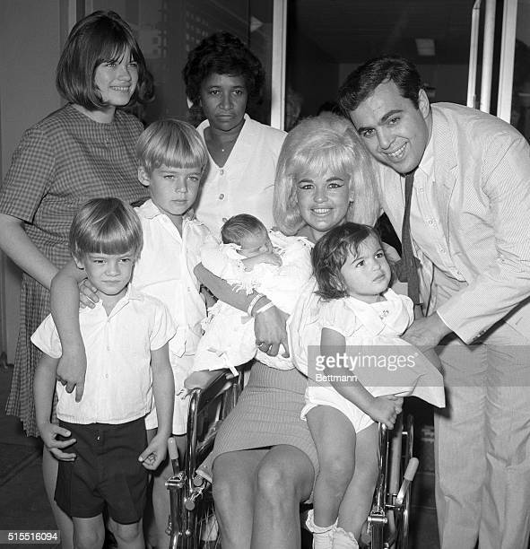 Actress Jayne Mansfield and family are pictured here as the blonde actress leaves Cedars of Lebanon Hospital with the newest addition to the family...