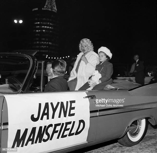 Actress Jayne Mansfield and her daughter Jayne Marie Mansfield ride in the Hollywood Christmas parade in Los AngelesCalifornia