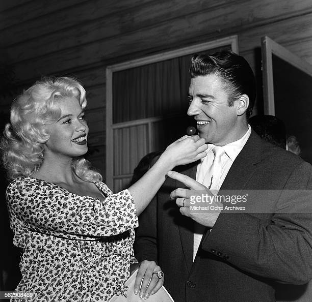 Actress Jayne Mansfield and Mickey Hargitay attend a party in Los AngelesCalifornia