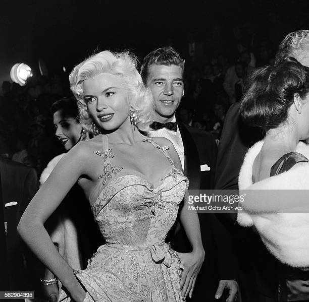 Actress Jayne Mansfield and Mickey Hargitay attend the premiere of Giant in Los AngelesCalifornia