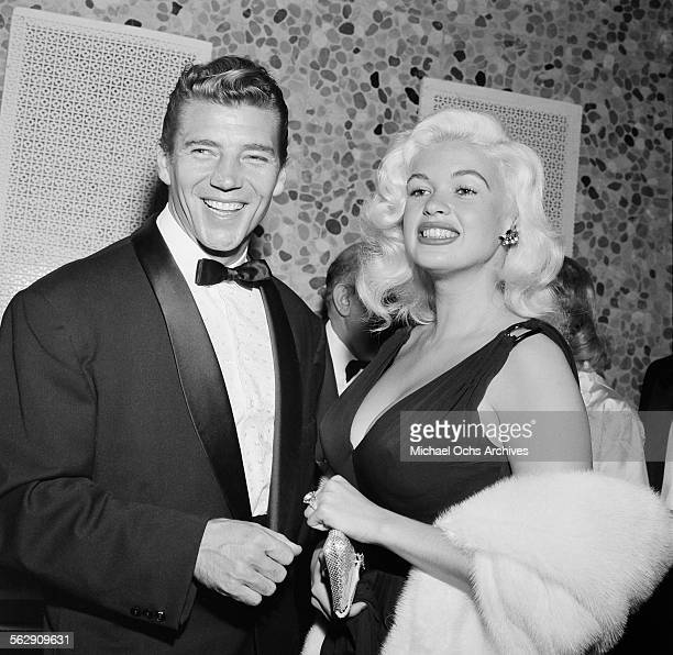Actress Jayne Mansfield and Mickey Hargitay attend the WAIF BALL in Los AngelesCalifornia