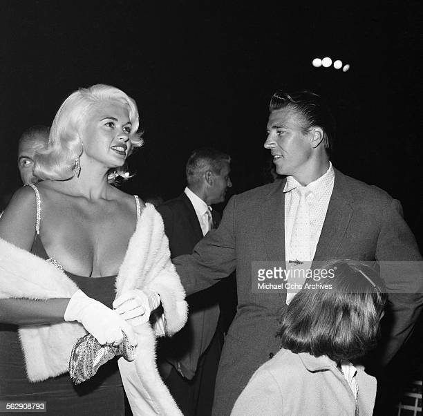 Actress Jayne Mansfield and Mickey Hargitay with daughter Jayne Marie Mansfield attend an event in Los AngelesCalifornia