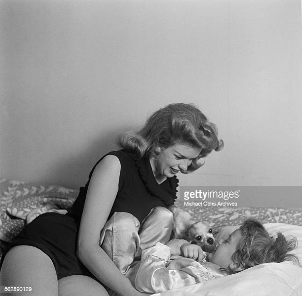 Actress Jayne Mansfield poses at home with her daughter Jayne Marie in Los AngelesCalifornia