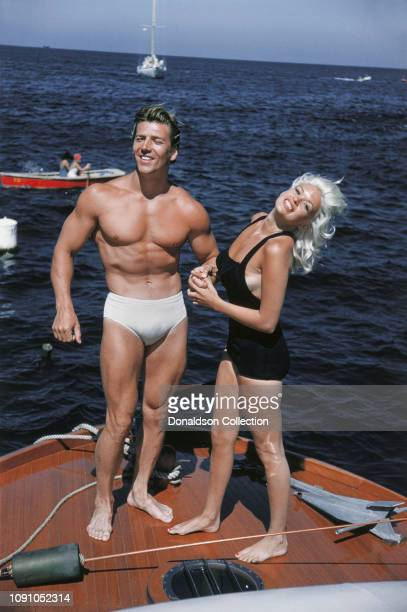 Actress Jayne Mansfield poses for a photo with husband Mickey Hargitay on their way to Catalina on July 22 1957 between Los Angeles and Catalina...