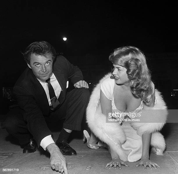 Actress Jayne Mansfield poses out on the town at Grauman's Chinese Theatre in Los Angeles,California.