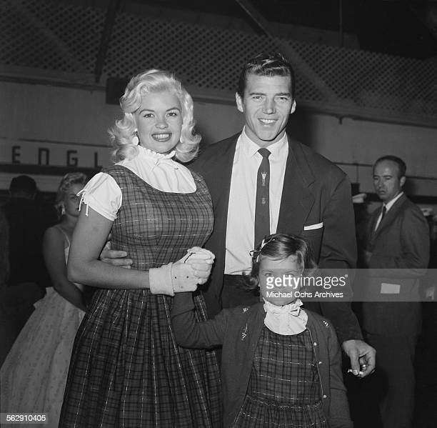 Actress Jayne Mansfield poses with her daughter Jayne Marie Mansfield and Mickey Hargitay during the Christmas Parade party in Los AngelesCalifornia