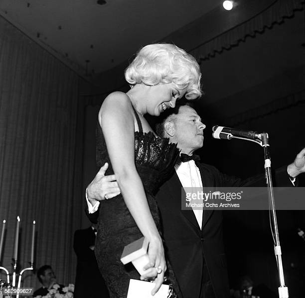 Actress Jayne Mansfield presents a Golden Globe award to actor Mickey Rooney who is collecting the special award for Cantinflas in Los...