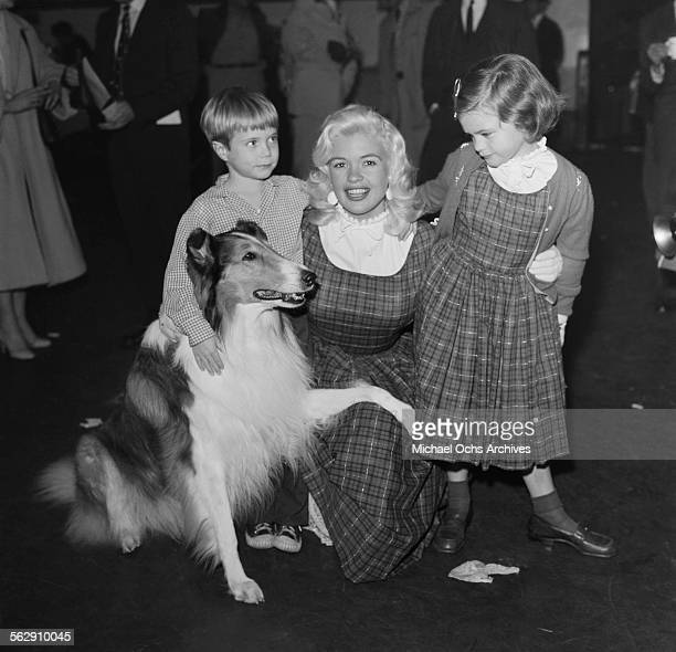 Actress Jayne Mansfield with her daughter Jayne Marie Mansfield pose with actor Jon Provost and Lassie during the Christmas Parade party in Los...