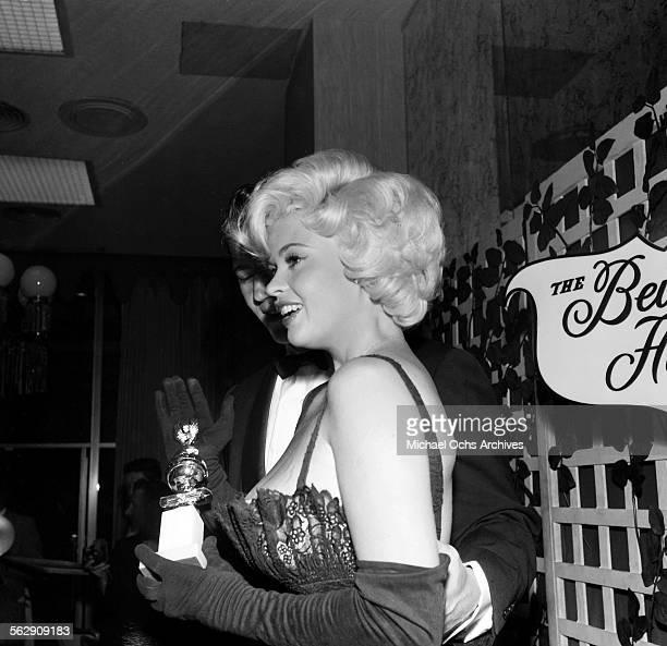 Actress Jayne Mansfield with husband Mickey Hargitay poses during the Golden Globe Awards in Los AngelesCalifornia