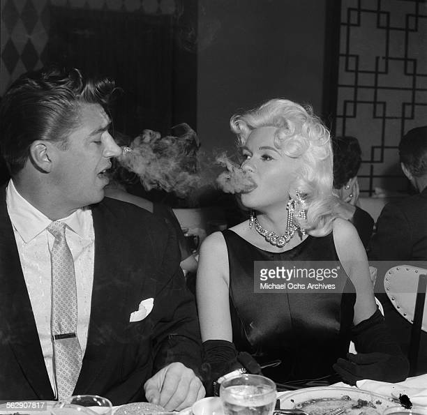 Actress Jayne Mansfield with Mickey Hargitay attend a Liberace party in Los AngelesCalifornia