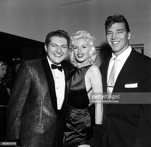 Actress Jayne Mansfield with Mickey Hargitay pose with Liberace during a party in Los AngelesCalifornia