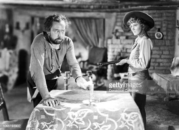 Actress Jean Arthur and Porter Hall in a scene from the movieArizona