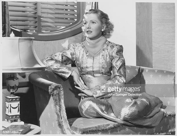 Actress Jean Arthur Sitting in a Chair