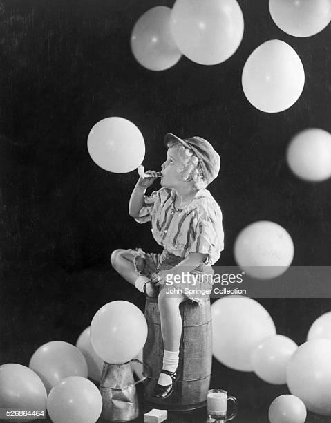 Actress Jean Darling Blowing Up Balloons
