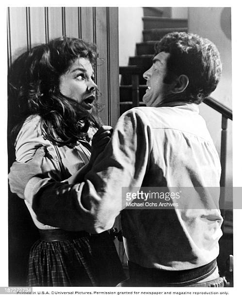 """Actress Jean Simmons and actor Dean Martin on set of the Universal Studio movie """"Rough Night in Jericho"""" in 1967."""