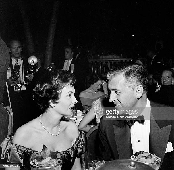 Actress Jean Simmons and husband actor Stewart Granger attend the Golden Globe Awards at the Cocoanut Grove in Los AngelesCA