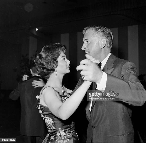 Actress Jean Simmons and husband actor Stewart Granger dance as they attend an event in Los AngelesCA