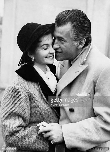 Actress Jean Simmons greets her husband actor Stewart Granger at London Airport 1954