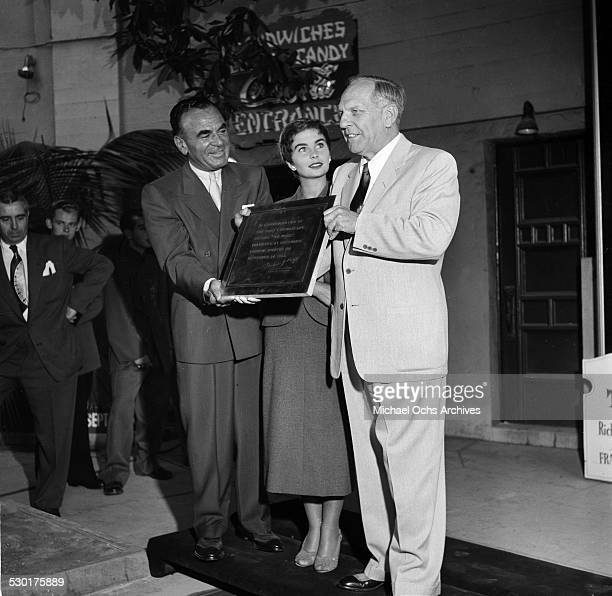Actress Jean Simmons receives a plaque and immortalizes her foot prints and hand writing at Graumen's Chinese Theatre in HollywoodCA