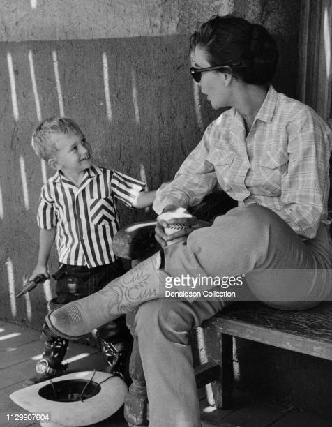 Actress Jean Simmons with a boy on the set of a movie in 1958