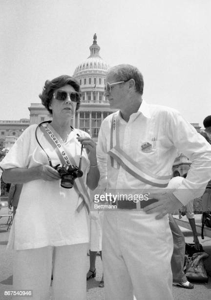 Actress Jean Stapleton, who was moderator for the ERA rally in Washington, D.C. Talks to Governor Brendan Byrne of New Jersey on the steps of the...