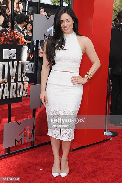Actress Jeanine Mason arrives at the 2014 MTV Movie Awards at Nokia Theatre LA Live on April 13 2014 in Los Angeles California