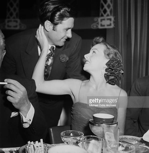 Actress Jeanne Crain with Paul Brinkman attend a party at Mocambo in Los Angeles California