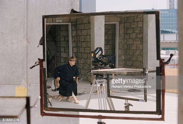 Actress Jeanne Moreau is reflected in a mirror while sitting on the set of the 2001 French television movie Zaide un Petit Air de Vengeance The film...