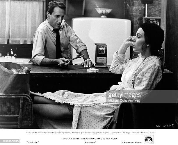 "Actress Jeannie Berlin and Roy Scheider on set of the movie ""Sheila Levine Is Dead and Living in New York"" , circa 1975."