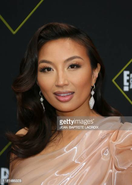 US actress Jeannie Mai arrives for the 45th annual E People's Choice Awards at Barker Hangar in Santa Monica California on November 10 2019