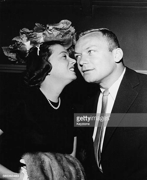 Actress Jeff Donnell leaning in to kiss her husband Aldo Ray on the cheek at an event in Hollywood CA circa 1955