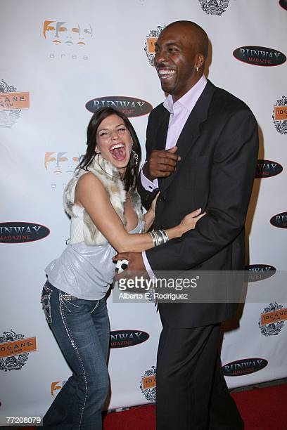Actress Jenae Alt and former NBA player John Salley arrive at the Runway Magazine launch party held at Area nightclub on October 5 2007 in West...