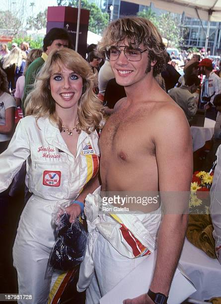Actress Jenilee Harrison and actor John Schneider attend the Fifth Annual Toyota Pro/Celebrity Race - Race Day on March 14, 1981 at the Long Beach...
