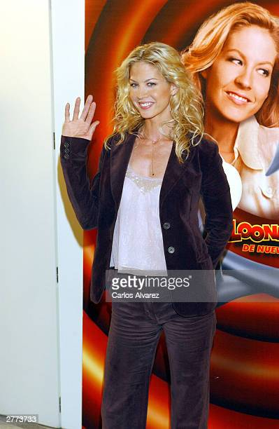 Actress Jenna Elfman gestures as she attends the promotional photocall for her new movie Looney Tunes Back In Action at Hotel Villamagna December 1...