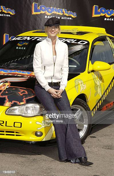 Actress Jenna Elfman poses for a photograph at the Looney Tunes Back in Action Race Car Pace Car and Spy Car unveiling at Warner Brothers Studios...