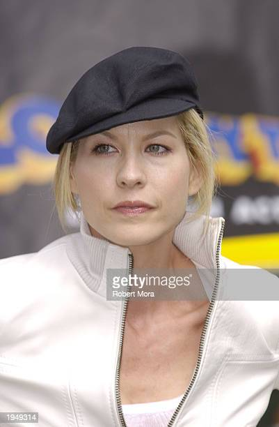 Actress Jenna Elfman poses for a photograph at the Looney Tunes Back in Action Race Car Pace Car and Spy Car unveiling at Warner Brothers Studios on...