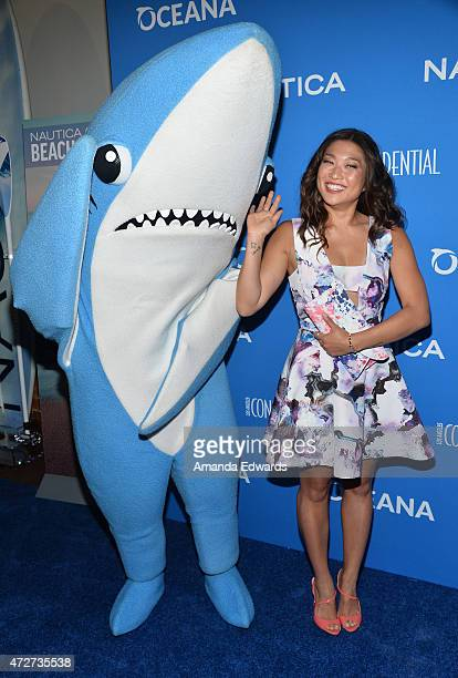 Actress Jenna Ushkowitz and Left Shark from the 2015 Super Bowl Katy Perry halftime show arrive at the 3rd Annual Nautica Oceana Beach House Party at...