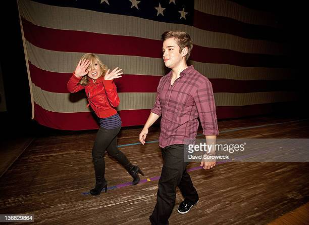 Actress Jennette McCurdy waves as she leaves the stage with Nathan Kress at Naval Submarine Base New London on January 11 2012 in Groton Connecticut...