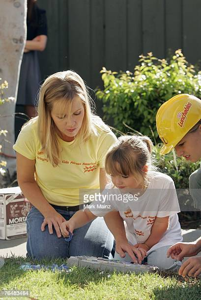 Actress Jennie Garth and daughters Luca Bella and Lola Ray help build a playground for underprivileged kids August 29 2007 in South Los Angeles...