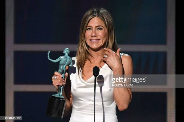 Actress Jennifer Aniston accepts the awards for Outstanding Performance by a Female Actor in a Drama Series during the 26th Annual Screen Actors...