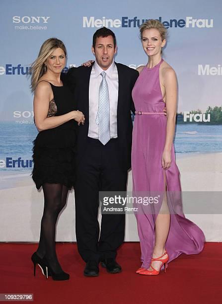 Actress Jennifer Aniston actor Adam Sandler and actress Brooklyn Decker attend the 'Meine Erfundene Frau' Germany Premiere at CineStar on February 21...