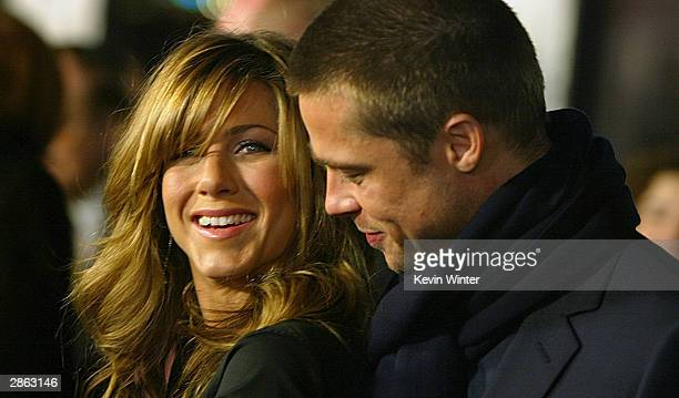 "Actress Jennifer Aniston and actor Brad Pitt attend the Los Angeles premiere of Universal Pictures' film ""Along Came Polly"" at the Grauman's Chinese..."
