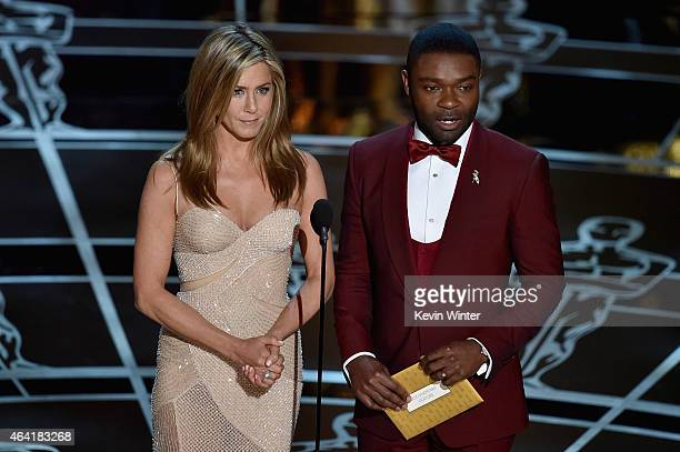 Actress Jennifer Aniston and actor David Oyelowo speak onstage during the 87th Annual Academy Awards at Dolby Theatre on February 22 2015 in...