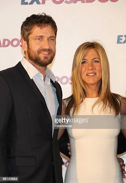 Actress Jennifer Aniston and actor Gerard Butler attend 'Exposados' photocall, at the Villamagna Hotel on March 30, 2010 in Madrid, Spain.