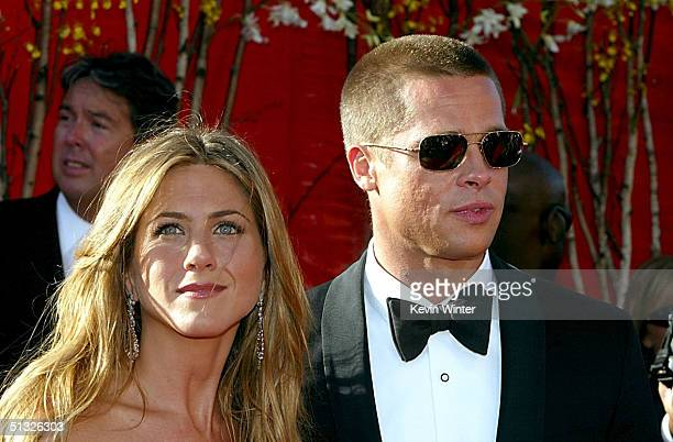 Actress Jennifer Aniston and Actor/husband Brad Pitt attend the 56th Annual Primetime Emmy Awards on September 19, 2004 at the Shrine Auditorium, in...