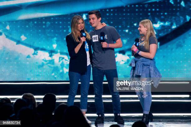 Actress Jennifer Aniston and and founders of the #neveragain movement and organizers of the March for our Lives Cameron Kasky and Jacqueline Coren...