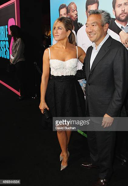 Actress Jennifer Aniston and chairman and CEO of Warner Bros Kevin Tsujihara attend the Los Angeles premiere of New Line Cinema's Horrible Bosses 2...